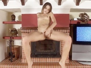 Fabulously sexy hottie spanking herself with strapon