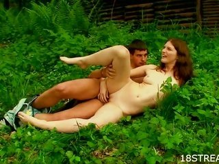 act of sexual procreation on the grass with spoilt curvacious