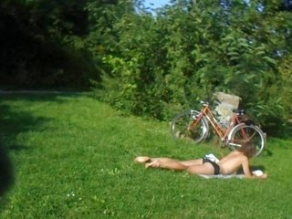 maiden Sunbathes Topless