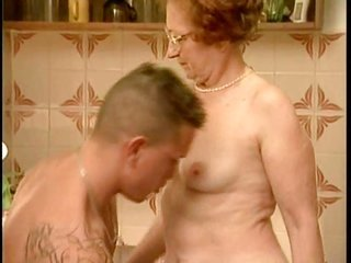 Granny catches pissed in the kitchen