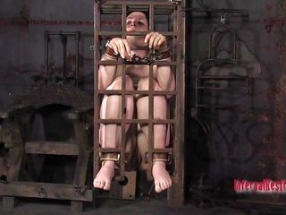Gagged extremely whorish girl in cage seizes some painful orgasm